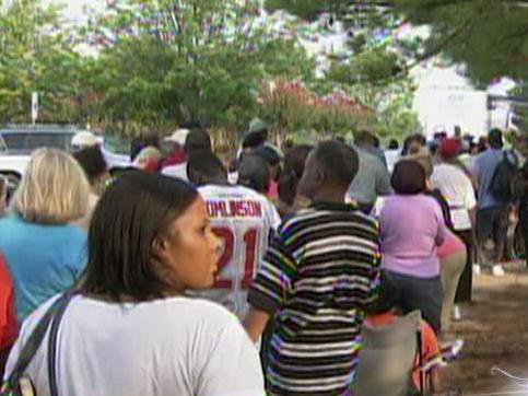 Hundreds line up outside the RBC Center on Aug. 12, 2011, for one of the largest free adult dental clinics in the state.