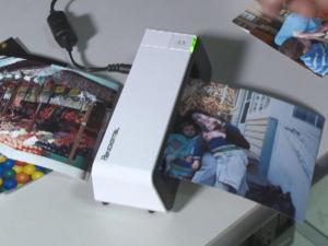 Portable photo scanners can digitize old photographs in seconds and save them to memory cards or directly onto a computer.