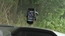 IMAGE: Hold the phone: Consumer Reports tests car smartphone holders