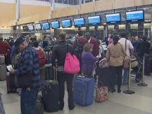 Travelers wait to check in at Raleigh-Durham International Airport.