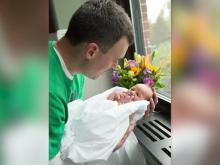 Bill Linden and his newborn