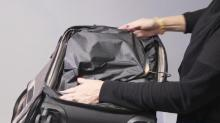IMAGE: Tuck and roll to maximize space in carry-on bags