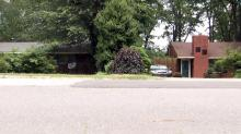 IMAGE: His driveway is on her property, and it's holding up her sale