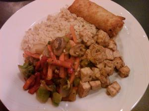 Teriyaki tofu, veggies, rice and a veggie egg roll