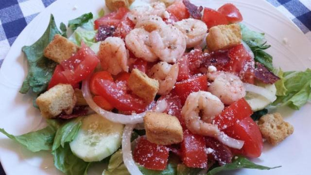 Garlic shrimp on salad