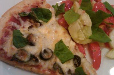 Homemade pizza with salad