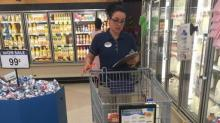 IMAGES: Fayetteville Food Lion surprises deployed soldier's wife with free groceries