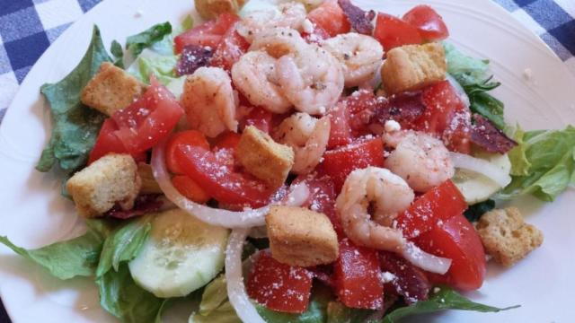 Sauteed shrimp on salad