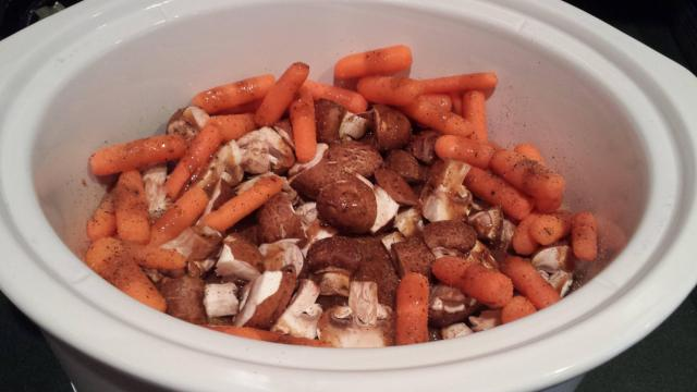 Chicken breast with baby carrots, portabella mushrooms and a roasted garlic balsamic dressing.