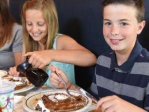 Kids eating at IHOP (photo via IHOP.com)