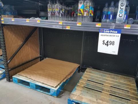 Empty bottled water shelves 9-9-18