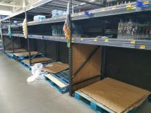 Empty bottled water shelves 9-9-18