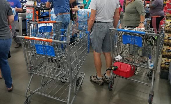 Customers crowding around pallet of bottled water near Clayton, NC 9-9-18