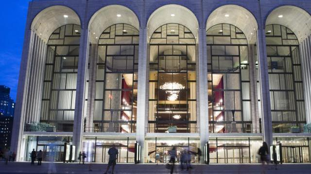 FILE - In this Aug. 1, 2014, file photo, pedestrians make their way in front of the Metropolitan Opera house at New York's Lincoln Center. (AP Poto/John Minchillo, File)