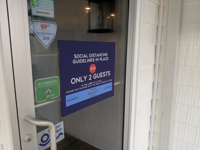 Ocean Isle Inn sign at office entrance