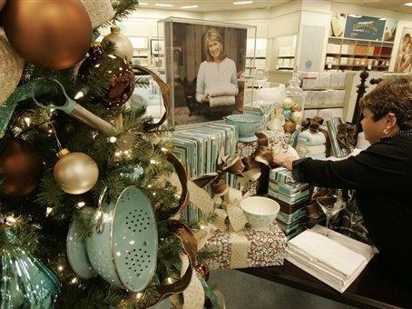 Macy's sales associate Vicki Hughes arranges a display of Martha Stewart products in the Macy's store at the Kenwood Towne Centre, Wednesday, Nov. 7, 2007, in Cincinnati. Macy's Inc. is turning to star power this holiday season handling collections by designers such as Stewart and Tommy Hilfiger U.S.A. to fight disappointing sales and resistance to its takeover of local department stores. (AP Photo/Al Behrman)