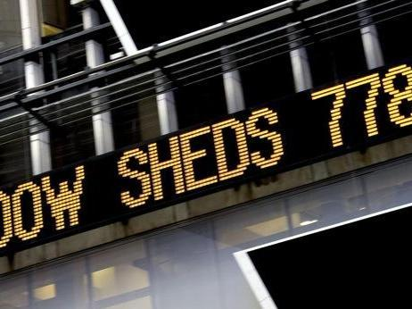 The news ticker shows a loss of 778 points on the Dow Jones industrials  on Times Square in New York. (AP Photo/Craig Ruttle)
