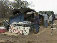 Strikers replaced by laid-off workers