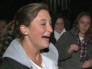 Sydney Holman reacts after leaving the Clayton Fear Farm on Oct. 29, 2010.