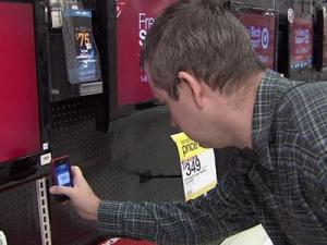 Tom Edwards used the Red Laser application on his iPhone to track down a deal on a television. While standing at the Target store in Cary, he used the application to check the prices at other retailers.