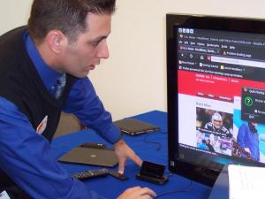 An AT&T employee demostrates the 4G Motorola Atrix.
