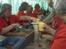 GSK workers package meals for children in Haiti and Nicaragua on