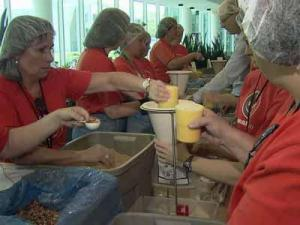 GSK workers package meals for children in Haiti and Nicaragua on Sept. 9, 2011.