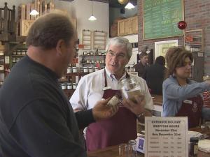 Bob Jones waits on customers at Savory Spice in Lafayette Village.