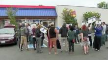 IMAGES: Fast-food workers walk out for more pay