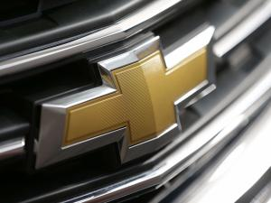 FILE - In this Feb. 14, 2013, file photo, This Photo taken Feb. 14, 2013 shows a Chevrolet logo on the grill of a 2013 Traverse at the 2013 Pittsburgh Auto Show in Pittsburgh. General Motors is recalling more than 1.5 million vehicles, including SUVs, vans and Cadillacs, for defective air bags and other problems. The recalls announced Monda, March 17, 2014, include the Chevrolet Traverse from the 2009-2013 model years. (AP Photo/Gene J. Puskar, File)