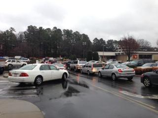 Shoppers lined up to exit Crabtree Valley Mall Wednesday afternoon after the power went out inside.