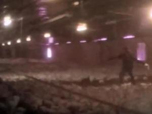 An image from hidden camera video provided by Mercy for Animals shows a worker throwing a chicken.
