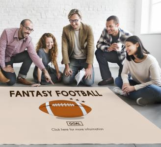 Fantasy football can drain a company's productivity, costing employers an estimated $16.8 billion over the course of the season. But could factors such as employee morale and networking with clients offset that projected loss? (Deseret Photo)
