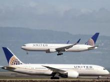 United receives criticism after man dragged off overbooked flight