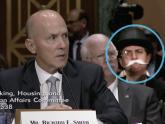 IMAGE: Monopoly Man photobombs Senate hearing on Equifax