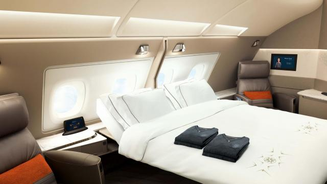 The Asian carrier on Thursday unveiled a new cabin design for its fleet of Airbus A380 superjumbo jets, featuring double beds, swivel chairs and personal wardrobes in private first-class staterooms.