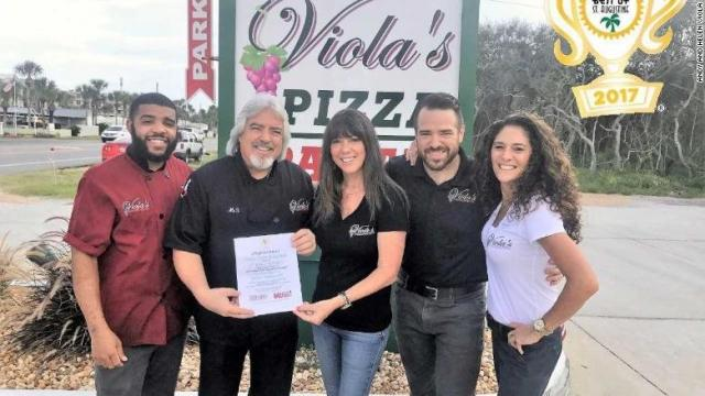 Andy (center left) and Helen (center) show off their Best Italian Restaurant award in St. Augustine. They are with their kitchen manager, Will Brooks (left), son A. J. Viola and daughter Sarah Viola.