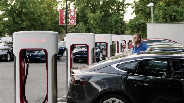 Edwin Stafford charges his Tesla at an electric charging station in Mountain View, Calif., Aug. 8, 2017. Prices for lithium-ion batteries are plummeting and technical advances are increasing driving ranges and cutting recharging times: Faster than anyone expected, electric cars are becoming as economical and practical as cars with conventional engines. (Jason Henry/The New York Times)