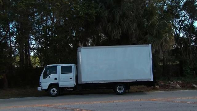 As the president completed another round at Trump International Golf Club in West Palm Beach, Florida, a large white truck obscured nearby journalists -- who were positioned on public property -- from getting a shot of Trump on their cameras.