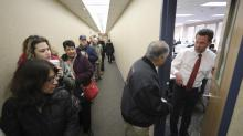 IMAGES: Last-Minute Rush to Prepay Taxes Gives Way to Confusion and Anger