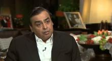 IMAGE: India's richest man buys brother's mobile business after pricing him out