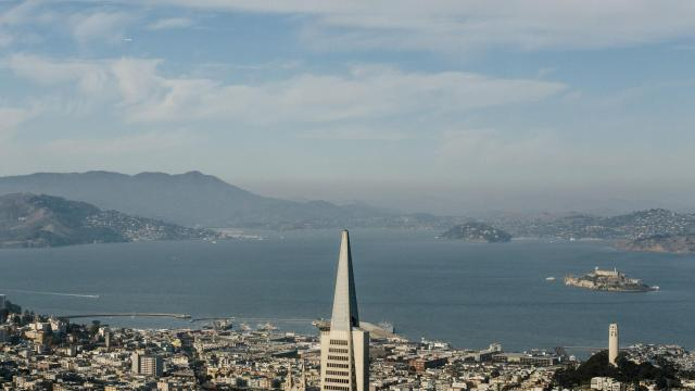 The Transamerica Pyramid seen from the 61st floor of the new Salesforce Tower in San Francisco, Dec. 18, 2017. Salesforce Tower, which at 1,070 feet is the tallest office building west of the Mississippi, will be inhabited in January, signaling tech's triumph in the city. (Jason Henry/The New York Times)