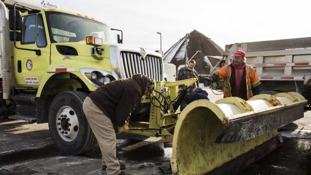 Crew members with the New Jersey Department of Transportation attach a plow to a salt truck in preparation for heavy snowfalls in Hamilton Township, N.J., Jan. 3, 2018. Florida, Georgia and South Carolina on Wednesday were feeling the frosty effects of a storm forecast to hit most of the Eastern United States, prolonging a stretch of strikingly bitter cold. (Bryan Anselm/The New York Times)