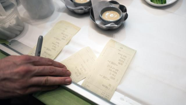 FILE — Order tickets in a restaurant kitchen in New York, Dec. 17, 2017. A move to allow restaurants and other employers to impose tip sharing on workers, and in some cases keep the money, is under fire from labor groups. (Daniel Krieger/The New York Times)