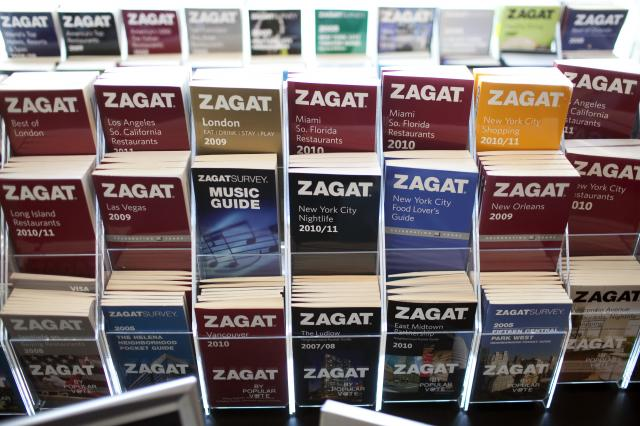 FILE -- An array of Zagat guides at the publishers' offices in New York, Nov. 10, 2010. Ownership of Zagat will change again in 2018 — into the hands of The Infatuation, an upstart restaurant review company that has harnessed smartphone apps, an Instagram hashtag and a texting recommendation service as parts of its path to growth. (Michael Falco/The New York Times)