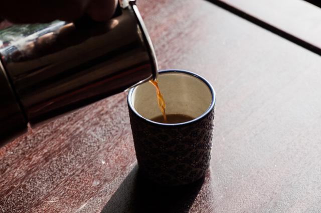 "FILE-- Coffee is poured into a cup in New York, Feb. 5, 2016. The coffee industry is mulling how to fight back against a California judge's 2018 ruling that would require the beverage to be branded with cancer warning labels. The National Coffee Association, whose members include Starbucks and Dunkin' Donuts, said that it was ""currently considering all of its options, including potential appeals and further legal actions."" (Alex Welsh/The New York Times)"