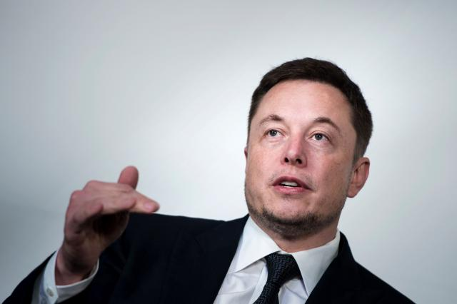 Elon Musk says he's finally ready to start making money.