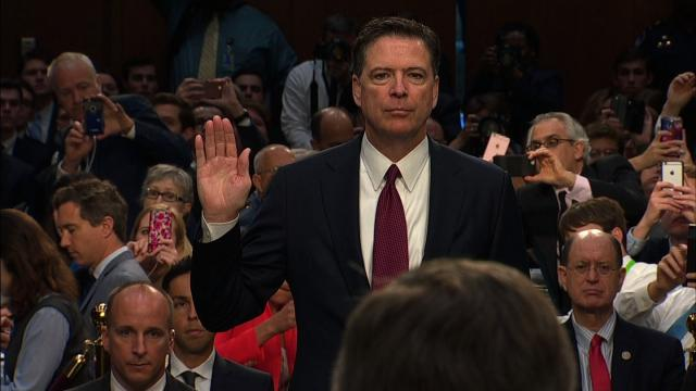 """File- During his first sit-down interview since being fired last year, former FBI Director James Comey reportedly compared President Donald Trump to a """"mob boss."""" Seen here is former FBI Director James Comey."""