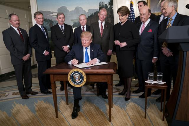 FILE — President Donald Trump signs a memorandum on trade policy with China, at the White House in Washington, March 22, 2018. Within the United States trade delegation there is little consensus about what concessions America should try and extract — or the best approach to getting the Chinese to agree. (Doug Mills/The New York Times)
