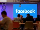 IMAGE: Facebook shuffles execs, bets on tech behind bitcoin